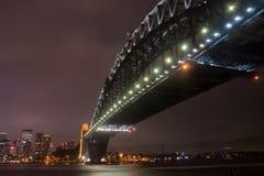 Sydney Harbour Bridge on a storm night. Sydney Harbour Bridge under lights on a storm night Stock Image