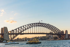 The Sydney Harbour Bridge at sunset in Sydney, Australia. Sydney, Australia - April 6, 2016: The Sydney Harbour Bridge at sunset in Sydney, Australia Stock Photography