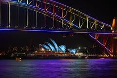 Sydney Harbour Bridge and Sydney Opera House duirng Vivid festiv. NTH SYDNEY, AUSTRALIA - JUNE 7, 2014; Sydney Harbour Bridge and Opera Hopuse in vibrant colours Royalty Free Stock Photo
