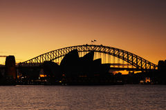 Sydney Harbour Bridge and Sydney Opera House at su Royalty Free Stock Image