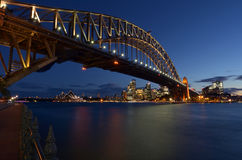 Sydney Harbour Bridge and Sydney Skyline at dusk Royalty Free Stock Images