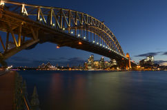 Sydney Harbour Bridge and Sydney Skyline at dusk Stock Images
