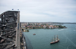 Sydney Harbour Bridge and Tall Ship. SYDNEY,NSW,AUSTRALIA-NOVEMBER 20,2016: Elevated view of climbers on the Sydney Harbour Bridge with tall ship in the royalty free stock photos