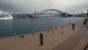 Sydney harbour bridge time lapse skyline shot at Sydney opera house circular quay wharf stock video footage
