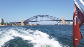 Sydney Harbour Bridge, View From Boat Travelling West Along Harbour, Australia. View of Sydney harbour and the Harbour Bridge from a boat or ferry sailing west stock footage