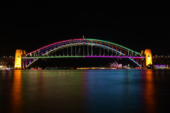 Sydney harbour bridge in Vivid colour. SYDNEY, AUSTRALIA - JUNE 2, 2014; The Sydney Harbour Bridge illuminated in beautiful colorus of magenta pink, purple, red Stock Photography