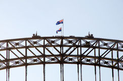 Sydney Harbour Bridge walking. People walking on the top of  Sydney Harbour Bridge with Australian flags beautiful blue summer sky. Sydney Opera House Guided Royalty Free Stock Photos