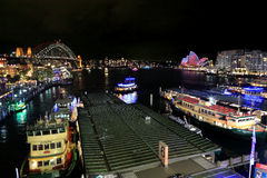 Sydney Harbour, City, Circular Quay and The Rocks during Vivid S. SYDNEY, NSW, AUSTRALIA - JUNE 4, 2014; Wide angle landscape view overlooking Sydney Harbour Royalty Free Stock Images