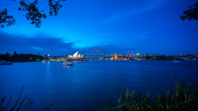 Sydney Harbour at Night. Beautiful scene of colorful Sydney city skyline at night with reflection Royalty Free Stock Images