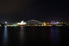 Sydney Harbour at Night. Beautiful scene of colorful Sydney city skyline at night with reflection Stock Images