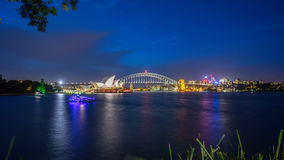 Sydney Harbour at Night. Beautiful scene of colorful Sydney city skyline at night with reflection Stock Photo