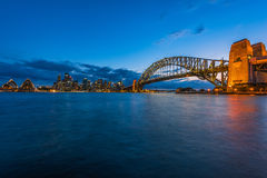 Sydney Harbour at night viewed from Milsons Point in North Sydney Australia. Royalty Free Stock Photo