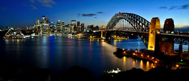 Sydney Harbour Panorama. Sydney CBD, harbour, bridge and Opera House viewed from Kirribilli at night Royalty Free Stock Images