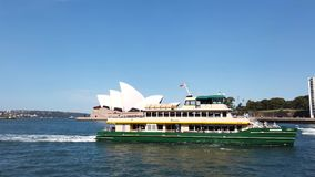 Sydney harbour Ferry Sailing Past the Opera House, Australia. A Sydney Harbour public transport ferry sailing past the Opera House into Circular Quay, NSW stock video