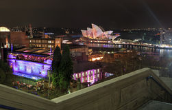 Sydney Harbour and The Rocks by Night. THE ROCKS, SYDNEY, NSW, AUSTRALIA - JUNE 4, 2014;  View of Sydney Harbour and The Rocks by night during Sydney Vivid Stock Photography
