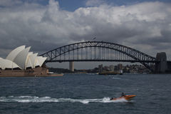 Sydney Harbour, showing opera house and bridge with speed boat in forground Royalty Free Stock Photo