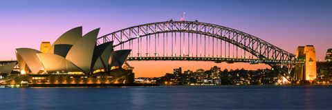 Sydney Harbour Skyline Panorama At Twilight. The opera house on the left and harbour bridge at the background Royalty Free Stock Image