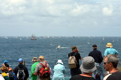 Sydney Hobart Yacht Race 2012. Sydney, Australia - December 26, 2012. Participants yachts reached the Tasman Sea. Spectators watching the race from South Head Royalty Free Stock Images