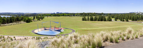 Sydney Homebush Olympic Park. A panorama of a park in Homebush with Sydney Olympic park in the distance Royalty Free Stock Images