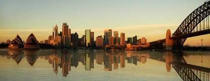 Sydney landmarks panorama. Evening photo, artificial reflection in water created in computer Stock Photos