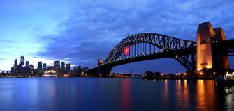 Sydney in Love. View of the Sydney Icon Harbour Bridge and the City in the evening Stock Photos