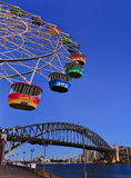 Sydney Luna Wheel Bridge Vertical. Australia sydney CBD and harbour bridge landmarks view from underneath ferrywheel with colorful cabins in the sky above the Stock Photography