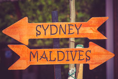 Sydney and Maldives direction sign. On the beach stock photos