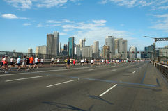 Sydney marathon. Runners just passed harbour bridge and are running to sydney cbd Stock Photography