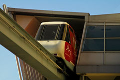 Sydney monorail. Red/white train leaving station above ground Royalty Free Stock Images