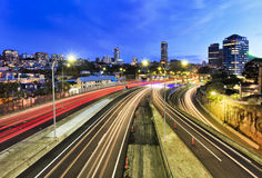 Sydney motorway lights domain. Sydney city domain suburb at sunset view above cross-city toll road motorway when car headligths are blurred and buildings are royalty free stock images