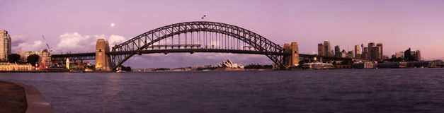 Sydney - Night City Skyline Panorama. Sydney Harbour Bridge just after sunset. Tilted perspective and blue toned. Long exposure and twilight. Horizontal panorama royalty free stock photos
