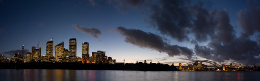 Sydney - Night Skyline Panorama. Sydney Harbour Bridge just after sunset. Horizontal panorama with space for text at the top royalty free stock image