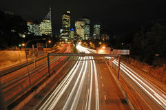 Sydney night traffic. Night traffic in Sydney, Sydney CBD in background, car light trails Stock Image