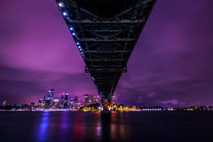 Sydney night view under harbour bridge Royalty Free Stock Images