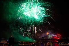 Sydney green fireworks. Green fireworks with boats parade at Harbour Bridge in Sydney bay at midnight for the new years eve 2015, shot from a boat royalty free stock photos