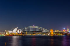 Sydney Opera and harbour bridge at night. View on Sydney opera and Harbour bridge at night, long exposure Royalty Free Stock Photography