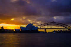 Sydney Opera and harbour bridge at sunset. View on Sydney opera and Harbour bridge at sunset Royalty Free Stock Image