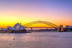 Sydney Opera and harbour bridge at sunset. View on Sydney Opera house and harbour bridge at sunset Royalty Free Stock Image