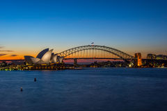 Sydney Opera and harbour bridge at sunset. View on Sydney Opera house and harbour bridge at sunset Royalty Free Stock Photos