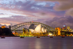 Sydney Opera and harbour bridge at sunset. View on Sydney opera and Harbour bridge in purple sunset, long exposure Royalty Free Stock Photo