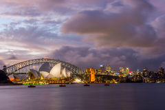 Sydney Opera and harbour bridge at sunset. View on Sydney opera and Harbour bridge in purple sunset, long exposure Stock Images