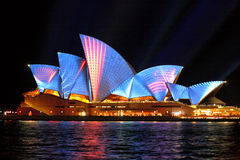 Sydney Opera Hosue illuminated in blue and red motion strips Royalty Free Stock Images
