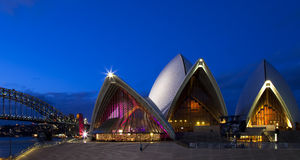 Sydney Opera House. And Harbour Bridge in the background after sunset Royalty Free Stock Photo