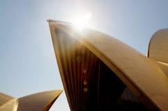 Sydney Opera House. World famous building Sydney Opera House in golden beam of sun rays. Sydney, Australia The Sydney Opera House is a multi-venue performing stock photo
