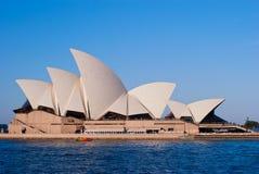 Sydney Opera House. On blue sky background, blue water surface Stock Photography