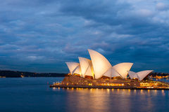 Sydney Opera House at blue night. Sydney, Australia - July 12, 2010 : View of the Sydney Opera House with nice clouds, sky background at blue night royalty free stock image