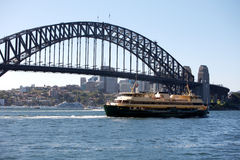 Sydney Opera House and bridge, Australia. Famous Sydney Harbour Bridge and ferry boat in the blue water, Australia Sydney Opera House and harbor bridge Stock Image
