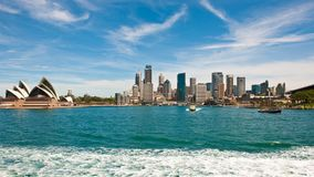 Sydney Opera House and Business District with Circular Quay railway station Stock Photos