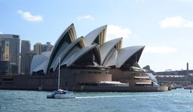 Sydney Opera House with a catamaran passing by. Sydney. New South Wales. Australia. Sydney is the state capital of New South Wales and the most populous city in royalty free stock image