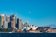 Sydney Opera House and Central Business District with Qantas pla Royalty Free Stock Images